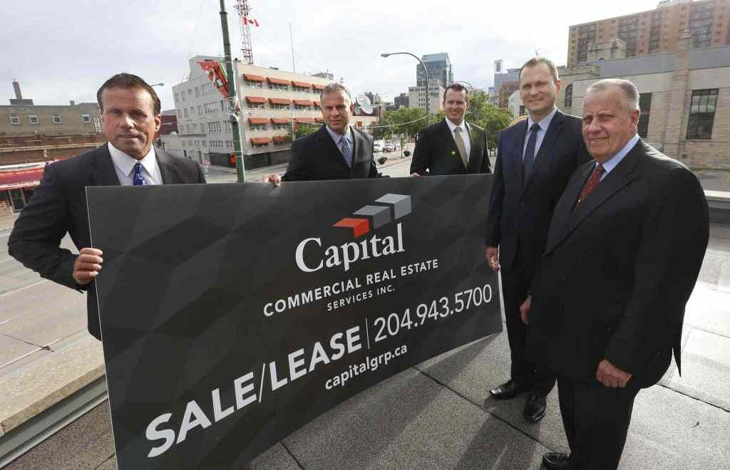 From left, Carey Chartier, Principal, Derrick Chartier, Principal, Trevor Clay, Principal, Rennie Zegalski, Principal and Marcel Chartier, Broker with a Capital Commercial Real Estate Services sign. The local office of real estate firm CBRE on Portage Ave is rebranding to Capital Commercial Real Estate Services.¤Geoff Kirbyson story. Wayne Glowacki / Winnipeg Free Press July 24 2015